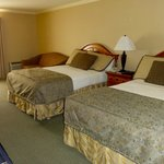 Two queen bed room included a couch and small table and two chairs