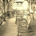 The rocking chairs on Maynard's front porch outside the restaurant. c2013 by chinagirl99