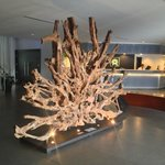 Wood sculpture greets guests upon arrival at front door