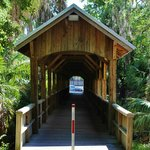 A small covered bridge welcomes the visitor