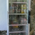 The fridge for soft drinks and beer