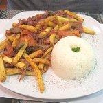 Lomo saltado, seasoned sirloin steak served with fries
