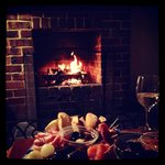 Antipasto & wine by thr open by the open fireplace