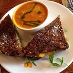 Outstanding green apple and cheddar grilled cheese with a cup of tomato soup