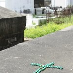 Many tombs had tokens of love:  coins, toys, or Mardi Gras beads.