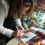 Beth signing her first copy of Wisconsin Supper Clubs - The Butterfly Club