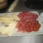 Excellente Tapas with goat cheese, Cerrano and olives