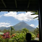 View of the volcano from our room (husband viewing from porch)