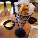 Frites with sweet ketchup and traditional aioli.