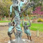 kids playing sculpture