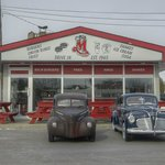 Old cars in front of Big M