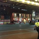 JW Marriott at night from the sidewalk of the Cafe Palace on Canal Street - sitting having a cof
