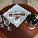 Champagne and fruits/chocolate