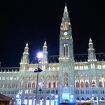 Rathaus building lit up at night