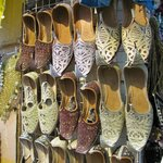 Fancy footwear for sale at the Muttrah Souq, facing the Corniche.