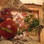 hamburger with cute pot of salsa,,salad and fries