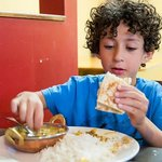 Enjoying his curry and naan