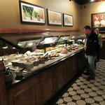 The help yourself salad bar counts as one of two side orders with the main course