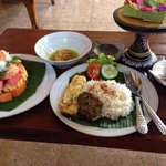 Balinese breakfast with fruit salad and Balinese coffee