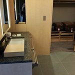 One of two bathromm sinks with luggage room to rear