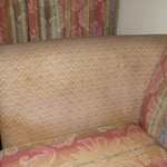 Stained and old sofa