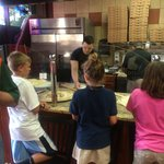 Kids amazed by the pizza process
