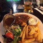 Chicken schnitzel, chips, salad, brown gravy, aioli sauce, beer. The Sherlock Holmes Pub. Melbou