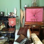 The mini grand piano in the background. Found years ago and needed repair and renovating. A hen