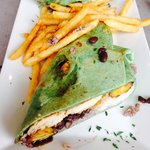 Cuban Chicken Wrap (spinach tortilla) with chicken, black beans, rice, and plantains (surprising