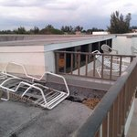 The broken down lounge chair left to rot on rooftop