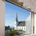 Upstairs victorian room view of ocean and church