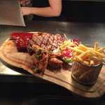Ultimate platter ( sirloin steak, half rack BBQ ribs salt and pepper chicken wings fries and sal