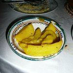 Cold potato's on manky chipped plate