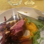 lamb two ways on carrot puree with  purple carrot on the side and a wonderful sauce