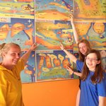 Louise, Dora and Maddie showing the dive sites they visited