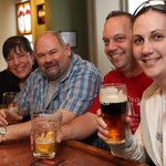 left to right, Katherine Brash and her husband Jim,Scott Mountney and Deana Wale enjoy a few of