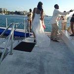 Enjoying the views, groomsmen setting sail in the background!