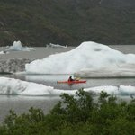 Kayaker on Mendenhall Lake in front of the glacier
