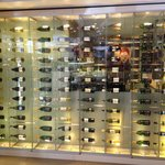 Wine bottle wall between lobby and bar