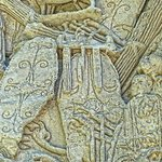 Closeup of shields on a relief on the imperial arch in Orange, France.