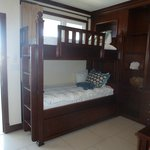 From the pocket door; entry door is to the left of the bunk bed.