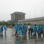 Tour group passing the Mausoleum on a humid rainy day.