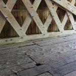 Worn floor wood and graffiti adorn the inside.