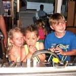 kid skippering boat
