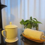 Green tea and wet towel are offered as  entering into the room