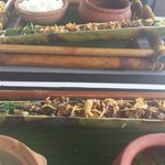 Main course of beef in bamboo sticks.