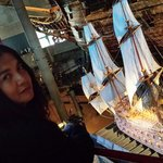I took a picture of my wife dee with the miniature Vasa ship in its glorious form in the backgro
