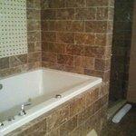 An amazing bathroom with a deep spa/tub.