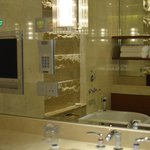sitting in tub you will see tv on mirror wall in front of you, one of two sink areas