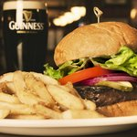 Our famous Guinness Burger paired with a pint of the dark stuff